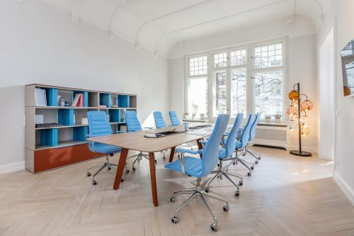A conference setting, with the Single model table from the Immerse range, Lotus chairs and a Be_Hold Design bookcase. Floor standing Meltdown lamp.